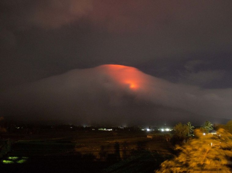 Almost 15,000 evacuated as lava flows from the Philippines' most active volcano