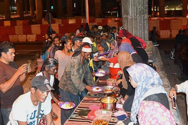Weekly buffet dinner for the homeless   - Nation
