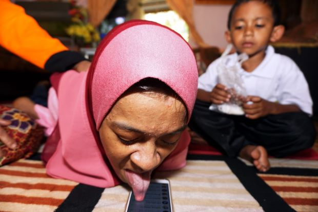 Disabled woman uses tongue to operate smartphone   - Nation