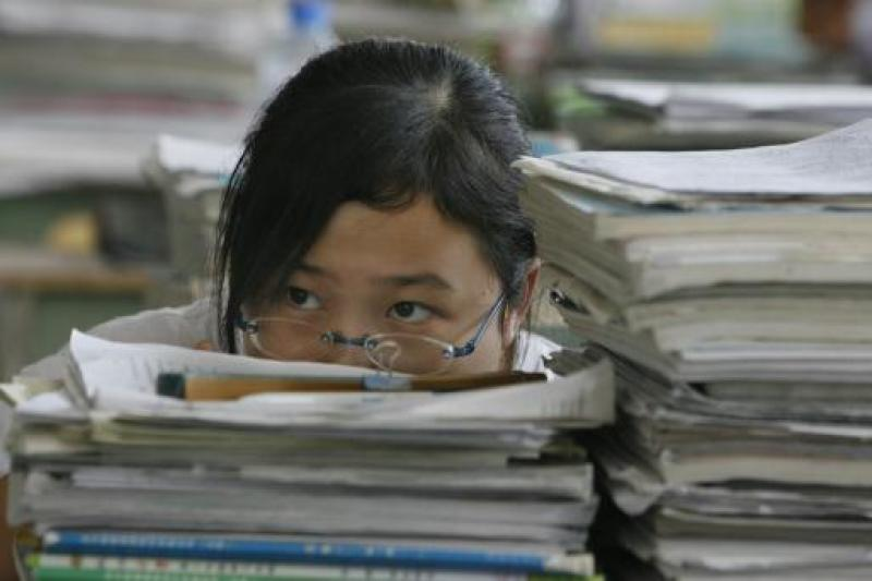 Chinese students spending less time on homework - under three hours a day