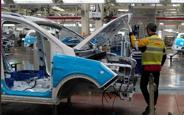 GM, DHL use Chinese plant to lead manufacturing change