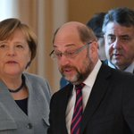 Germany's SPD votes to pursue coalition talks with Merkel's conservatives