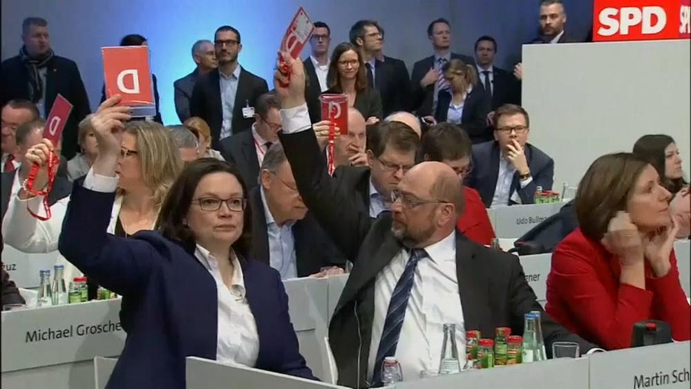 Germany's SPD back coalition talks in narrow vote