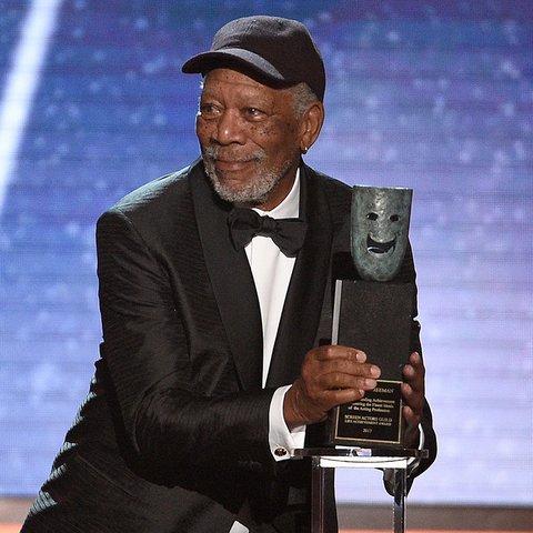 Morgan Freeman accepting his Life Achievement Award at the SAGAwards is ? a ? mood?.