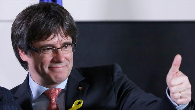 Carles Puigdemont, facing charges in Spain, to be Catalonia's new president