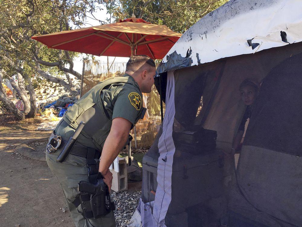 Cops move to clear massive California homeless encampment