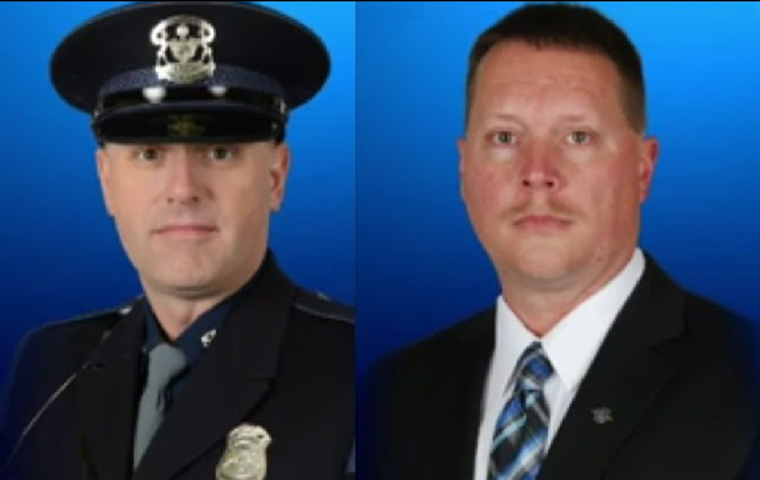 Two Michigan detectives shot during cold case probe