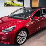 Drivers line up to see the Tesla Model 3 for the first time