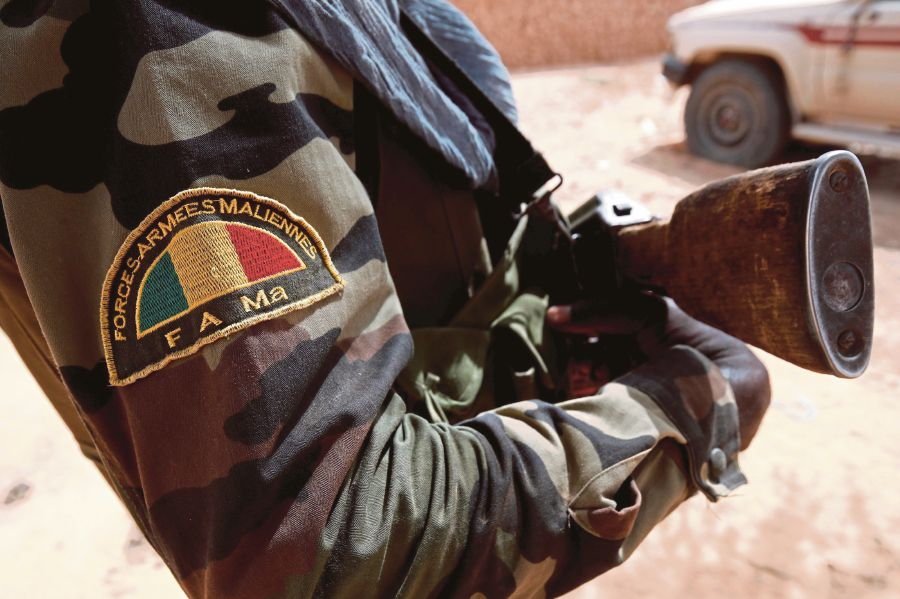 Gunmen kill at least 14 Mali soldiers in attack on army camp