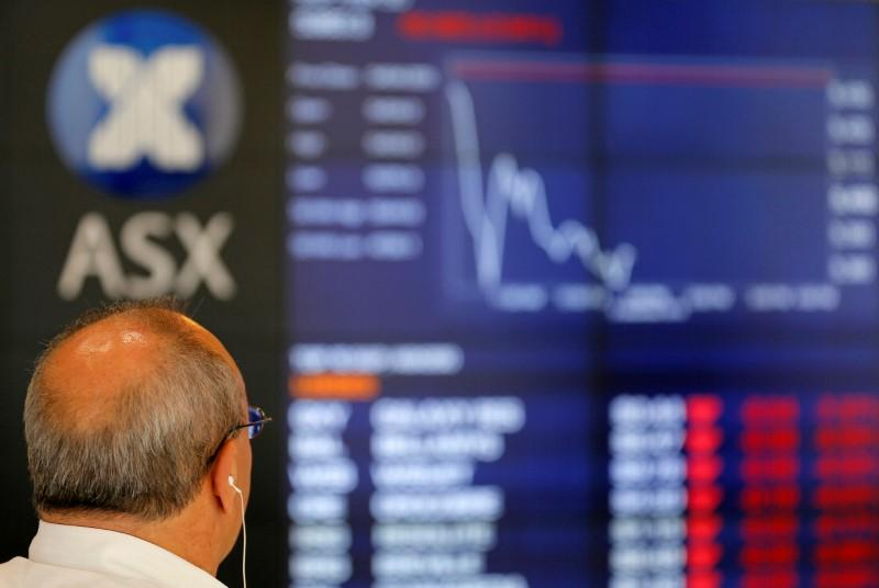 Asia shares extend bull run, dollar crawls off lows
