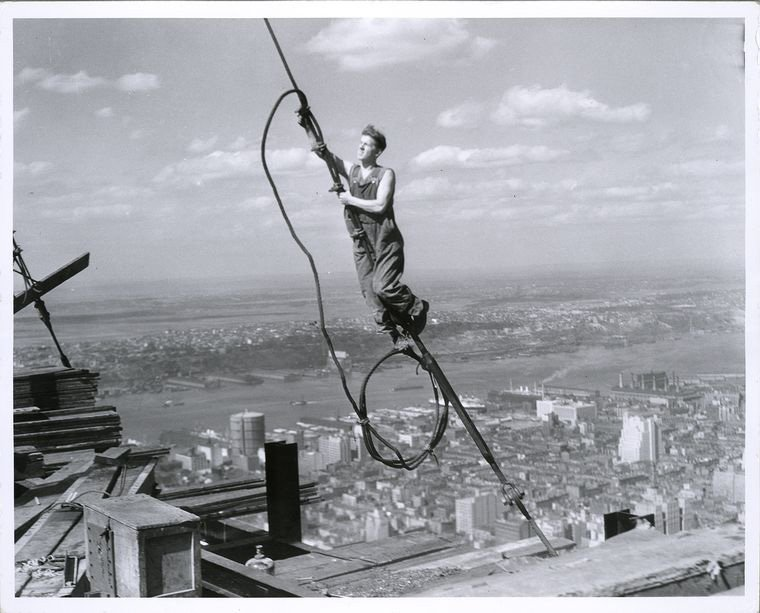 If it wasn't for the invention of the elevator New York City would look like Paris.  Here, a young man works on the Empire State Building, high above 34th St.
