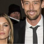 Doting dad Peter Crouch cradles his newborn son with Abbey Clancy on first day out since the birth