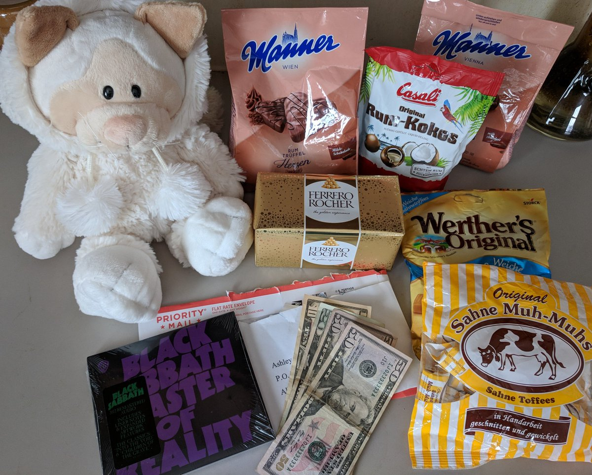 Presents from three good pets. International candies & stuffed cat, a CD from my wish list, and cash