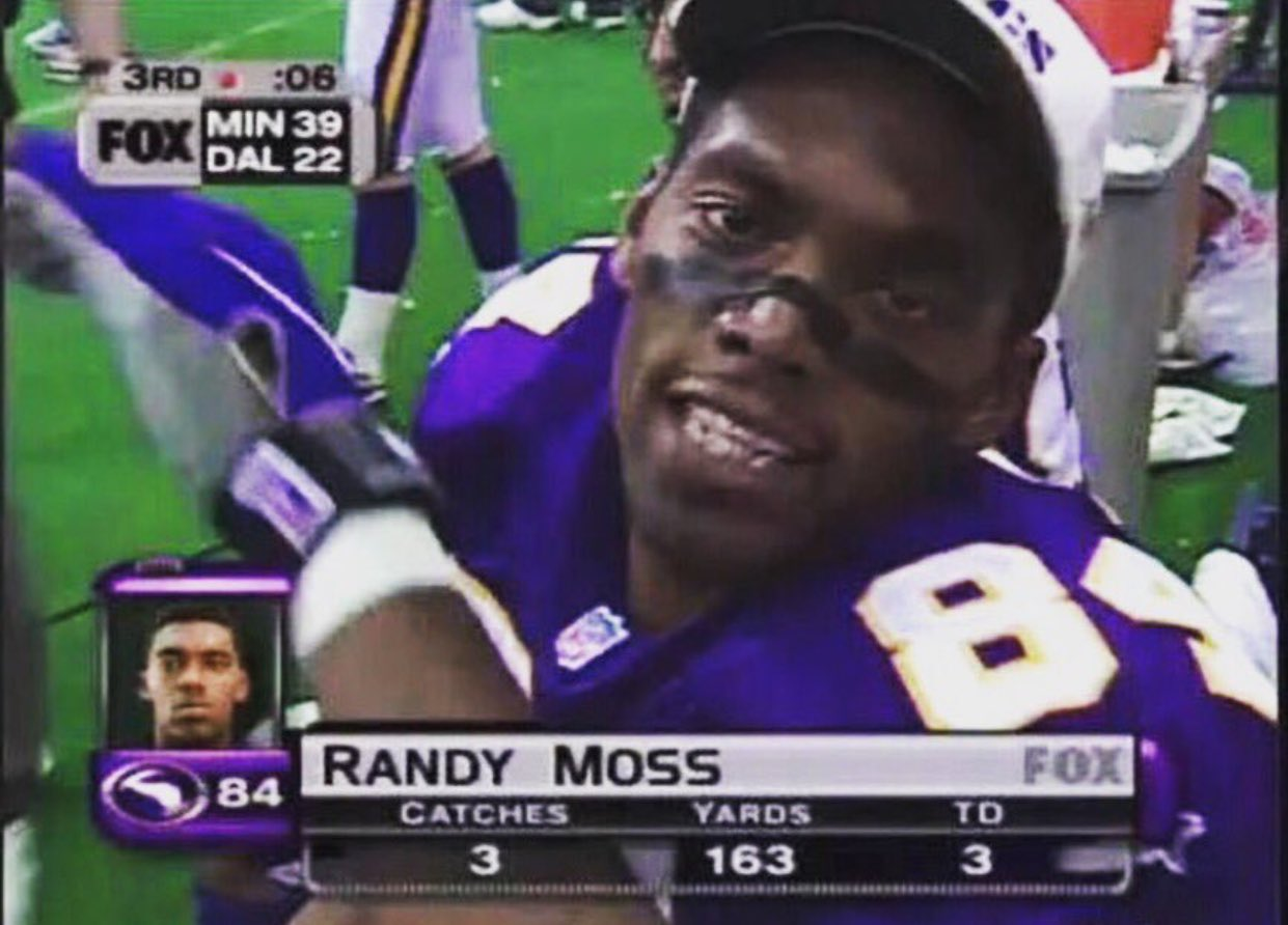 (1998) Just another day at the office.  Happy birthday Randy Moss!