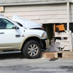 Truck crashes into Park N Shop building; 2 injured
