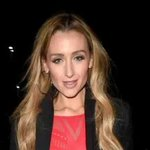 Catherine Tyldesley glams up in black leather skirt and red lacy top in honour of her beloved Salford Reds as she arrives to watch rugby match