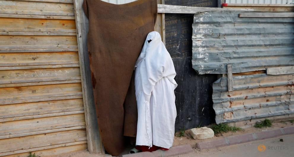 Men with guns still rule in Libya as return to 'ghost town' blocked