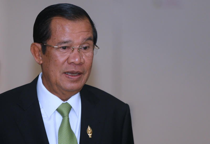 Cambodian PM Hun Sen calls rival Sam Rainsy 'crazy and stupid' over Facebook petition