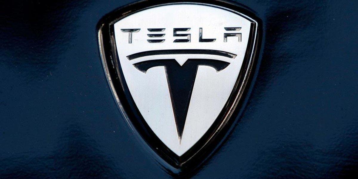 Tesla to release earnings as scrutiny grows