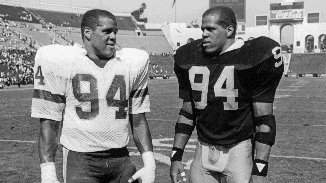 From the archives...  Raleigh and Reggie McKenzie, chopping it up after a game. https://t.co/iTZmdJN9EX