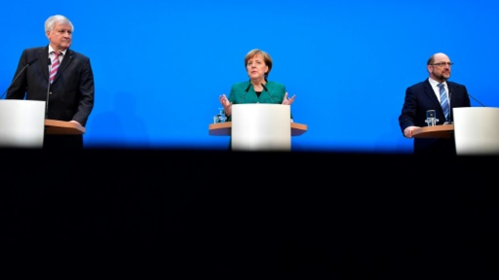 Grumbles in Merkel's ranks over deal with centre-left