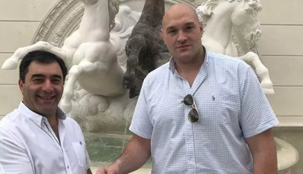 Tyson Fury 'treats himself to a new mansion' and poses beside massive columns at the property believed to be in Spain