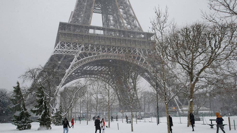 Eiffel Tower shuts down as snow, freezing rain pummel France