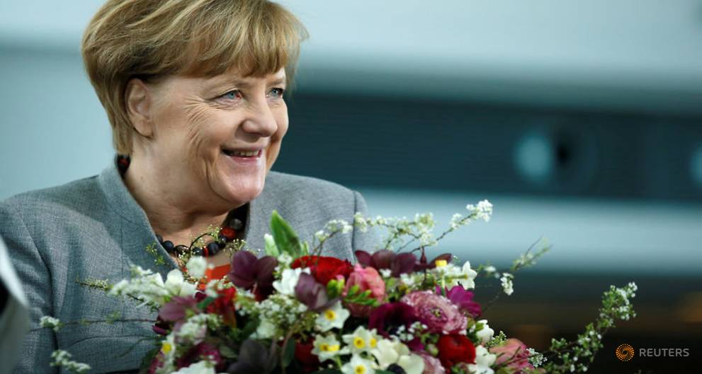 Critics in Merkel's conservatives vow to block coalition projects