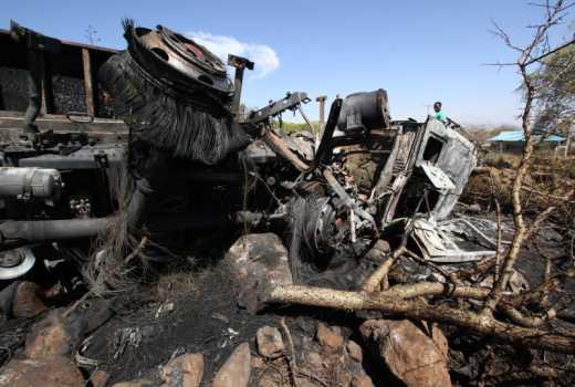 Four die after truck rams buildings