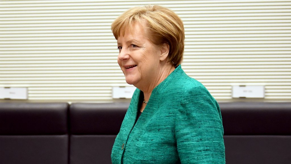 Germany's Merkel defends 'painful' coalition deal against critical party members