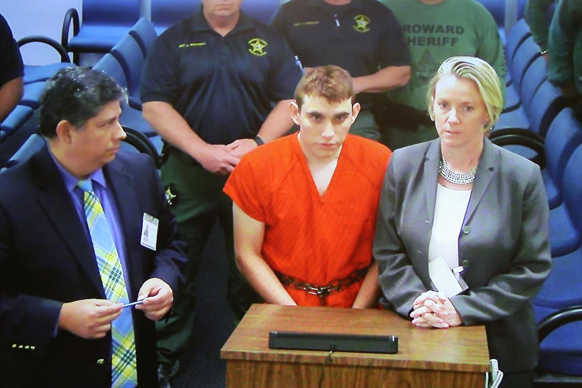 "Accused Florida shooter on suicide watch and ""sad"" and ""remorseful,"" lawyers say"