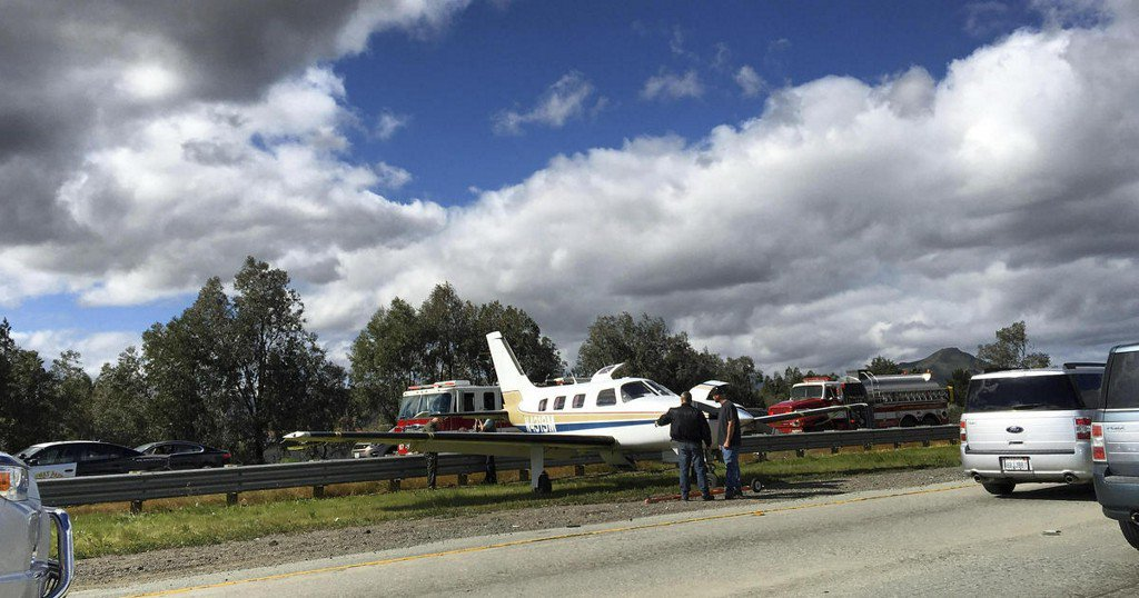 Plane lands on California highway median; no injuries reported