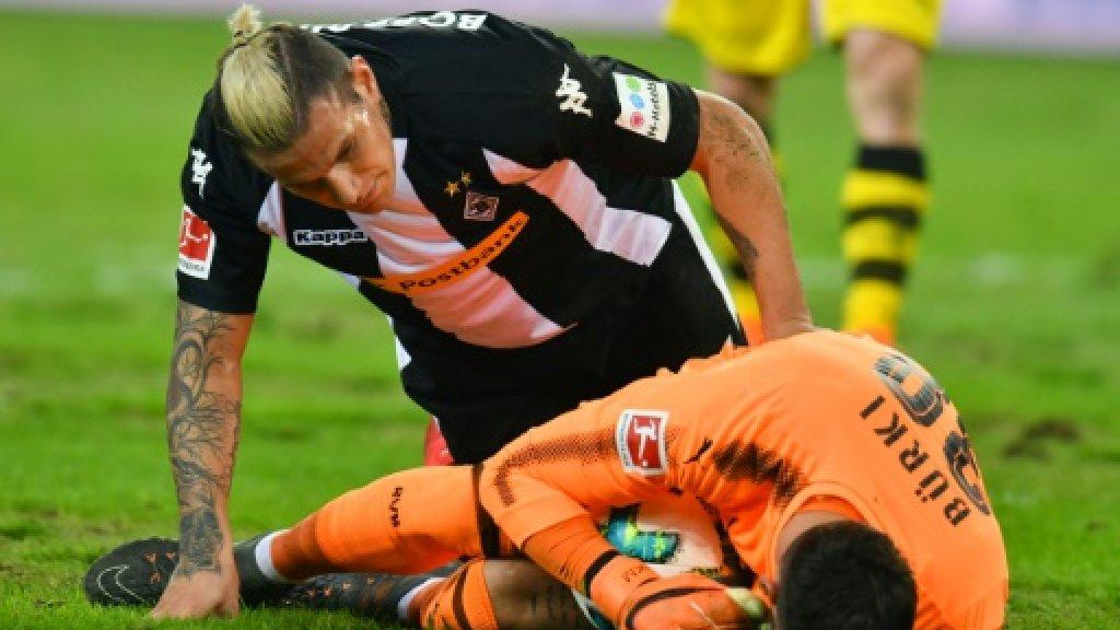Pitch battle as Reus ends goal drought in Dortmund win