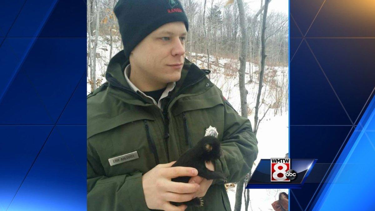 Aww! Maine ranger cuddles bear cub in viral photo