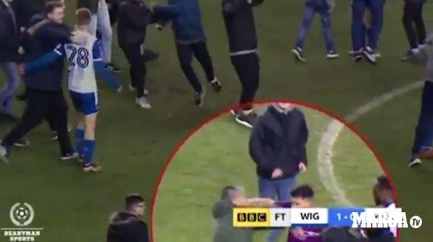 Pep Guardiola y el DT del Wiga wigan