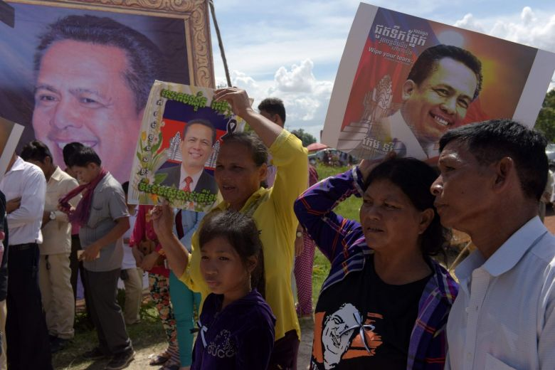 Family of murdered Cambodian government critic arrive in Australia