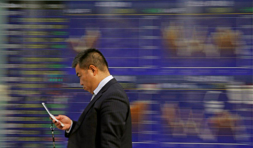 Asian stocks led higher by Japan a dollar extends recovery