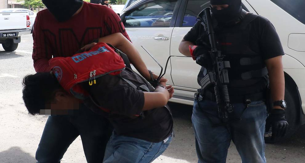 Malaysia arrests 10 suspects for helping militants enter southern Philippines from Sabah