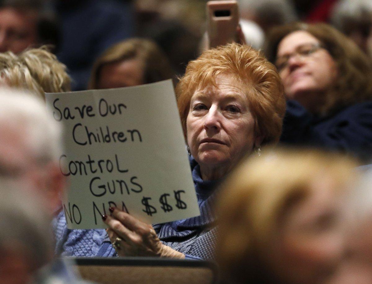 Colorado congressman booed as people demand action on guns