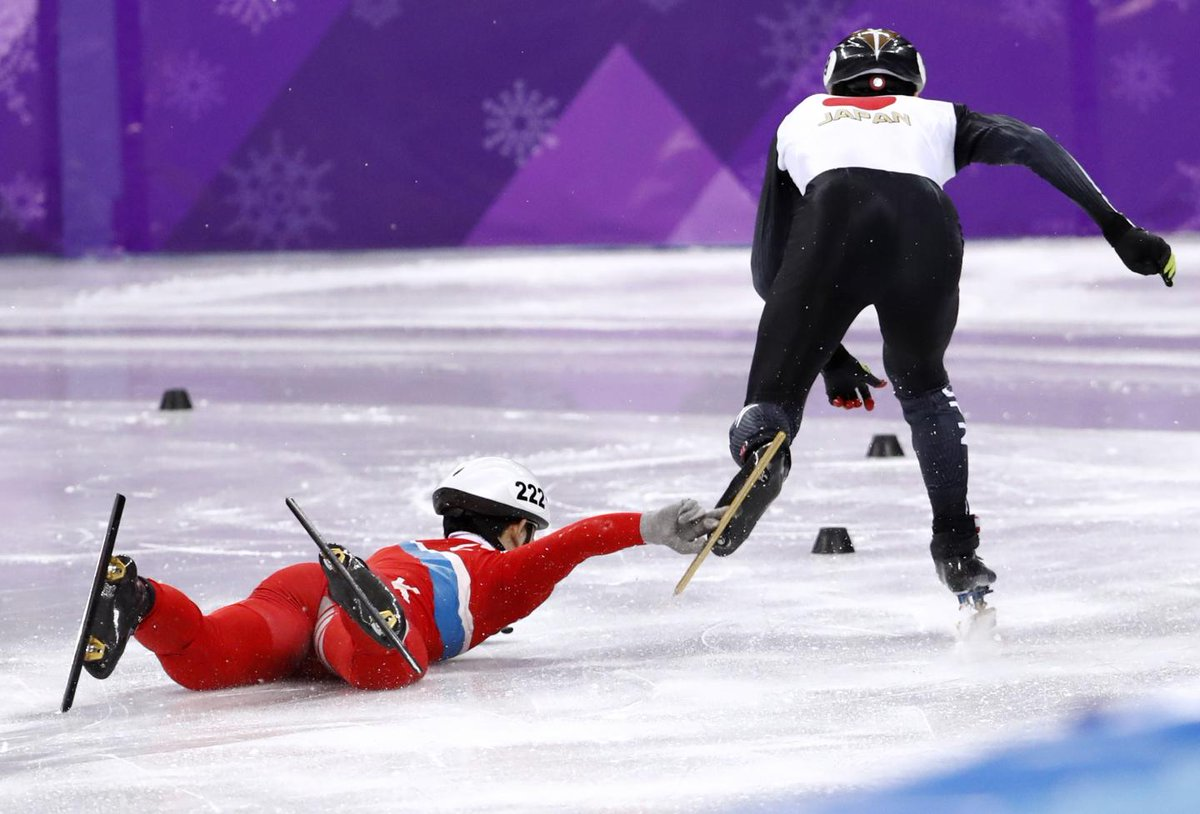 North Korean speed skater tries to grab Japanese rival's blade after falling down