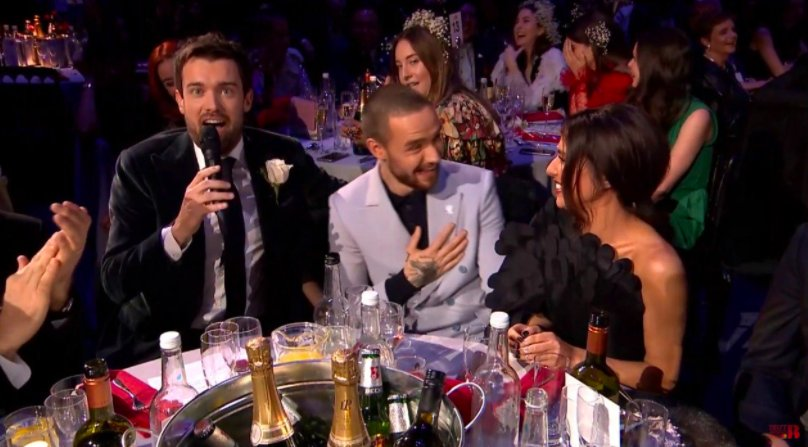 Este Haim Explains What She Was Doing Behind Chiam At The BRIT Awards