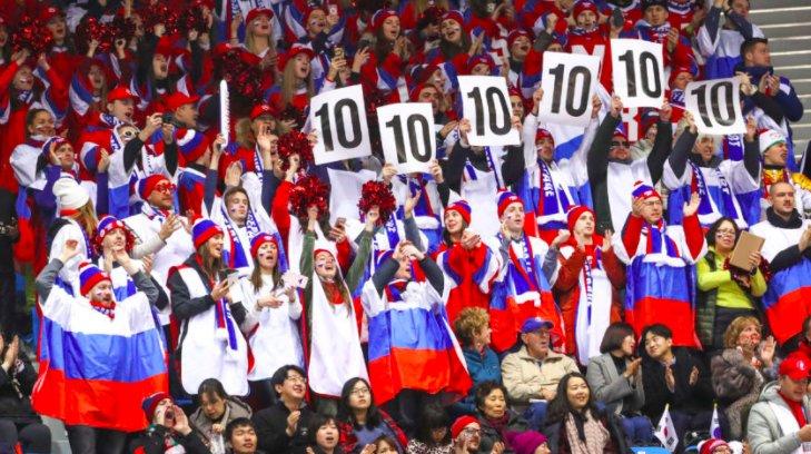 Go Kazakhstan! Go Japan! It doesn't matter to flag-waving skating fans.