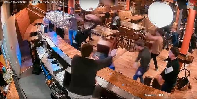 CCTV shows mass brawl in bar with glasses and chairs used as weapons