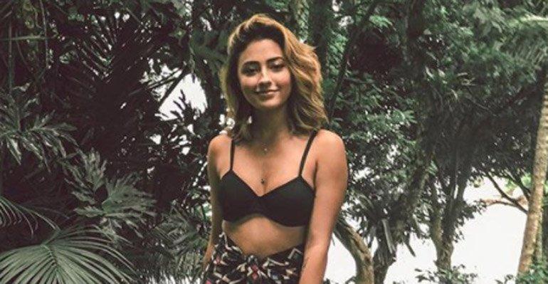 Carolina Oliveira. Foto do site da Caras Brasil que mostra Novo visual! Carolina Oliveira muda a cor de seu cabelo. Veja a mudança aqui