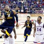 Devonte' Graham, Jevon Carter headline Big 12 All-Tournament team