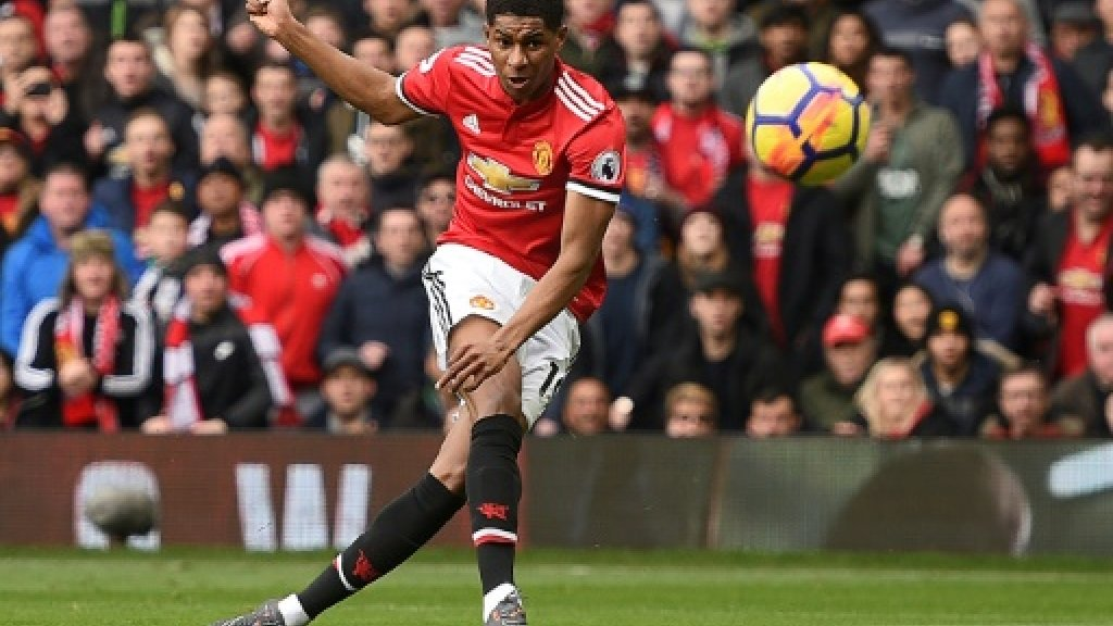 Rashford hits double as Man Utd hold off Liverpool