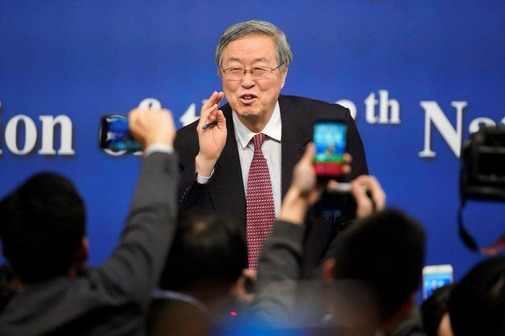 China to rely less on economic stimulus as it battles risks: central bank governor