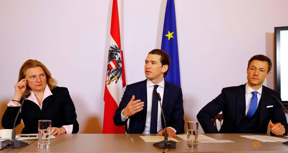 Austrian president fumes as police raids set off political storm