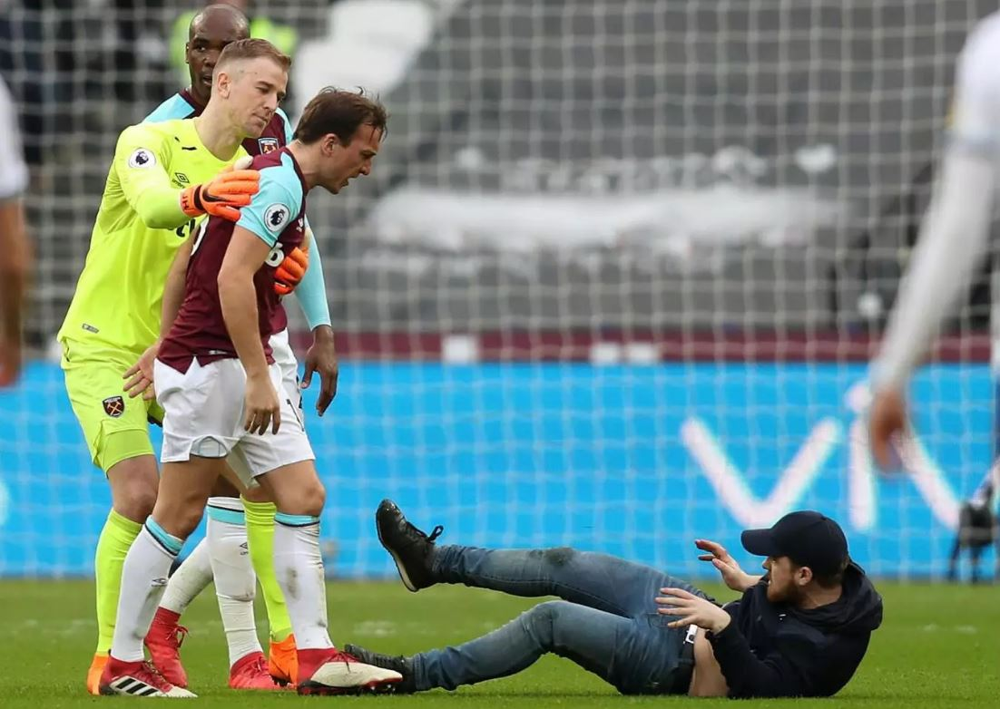 West Ham owners escorted from ground after pitch invasions from fans during heavy defeat to Burnley