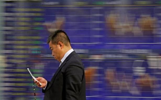 World shares climb on U.S. wage gain data